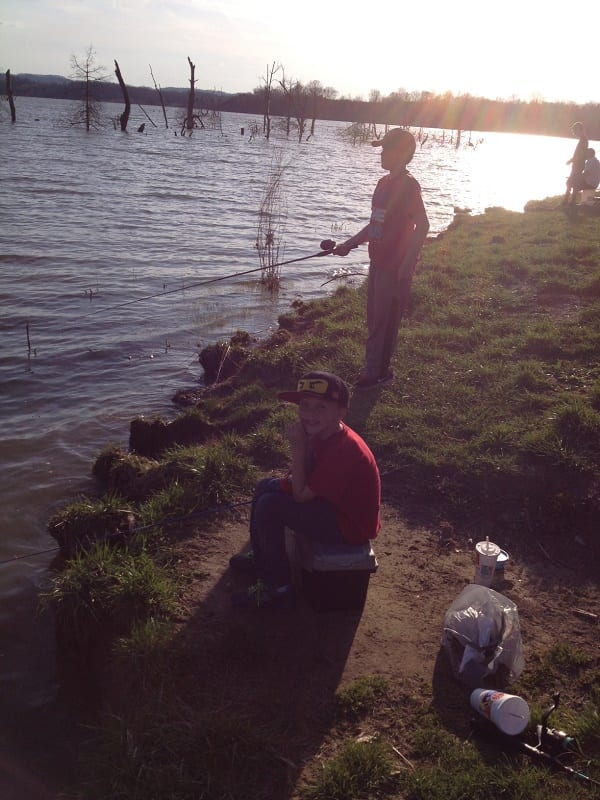 Cleaning up litter on our fishing trip hobbies on a budget for Cedar creek lake fishing