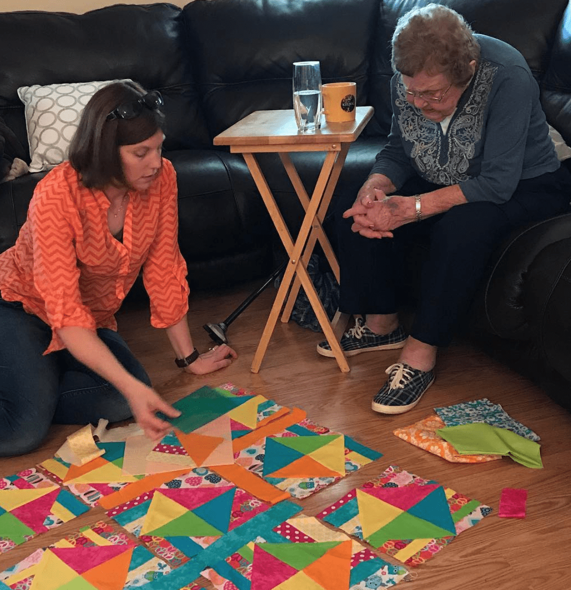 Sharon and Grandma working on quilt