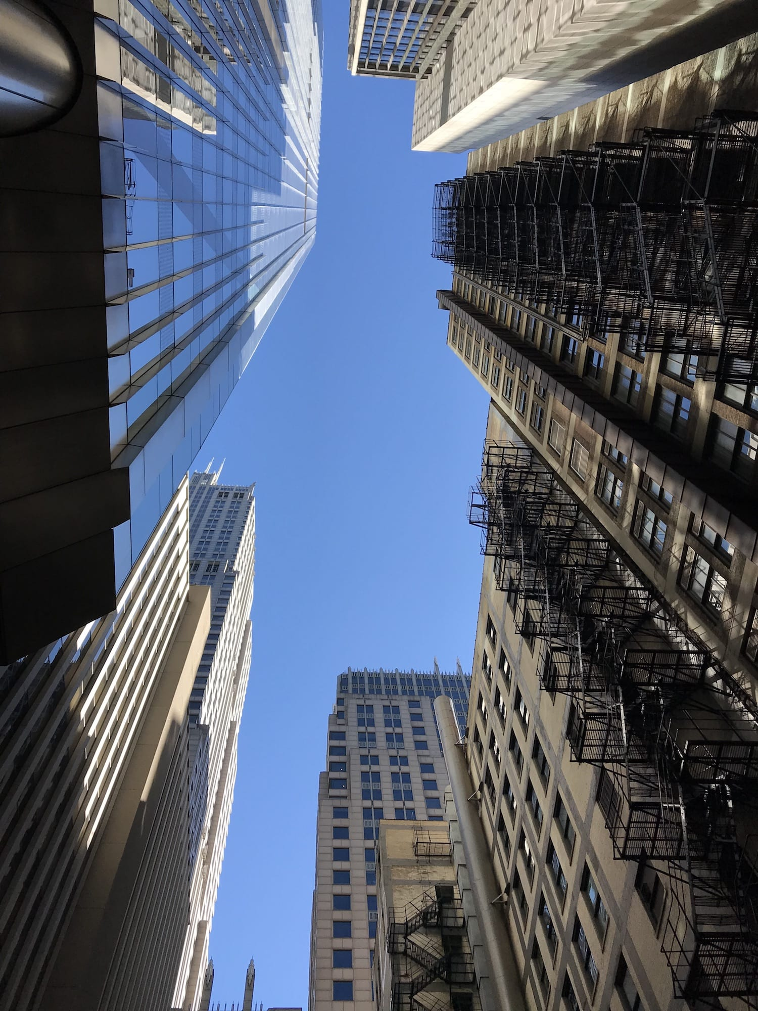 A view of Chicago looking up through the skyscrapers