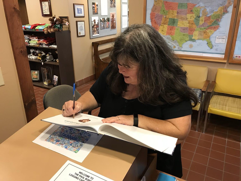Author Diana Peterson at Paul Bunyan Logging Camp Museum