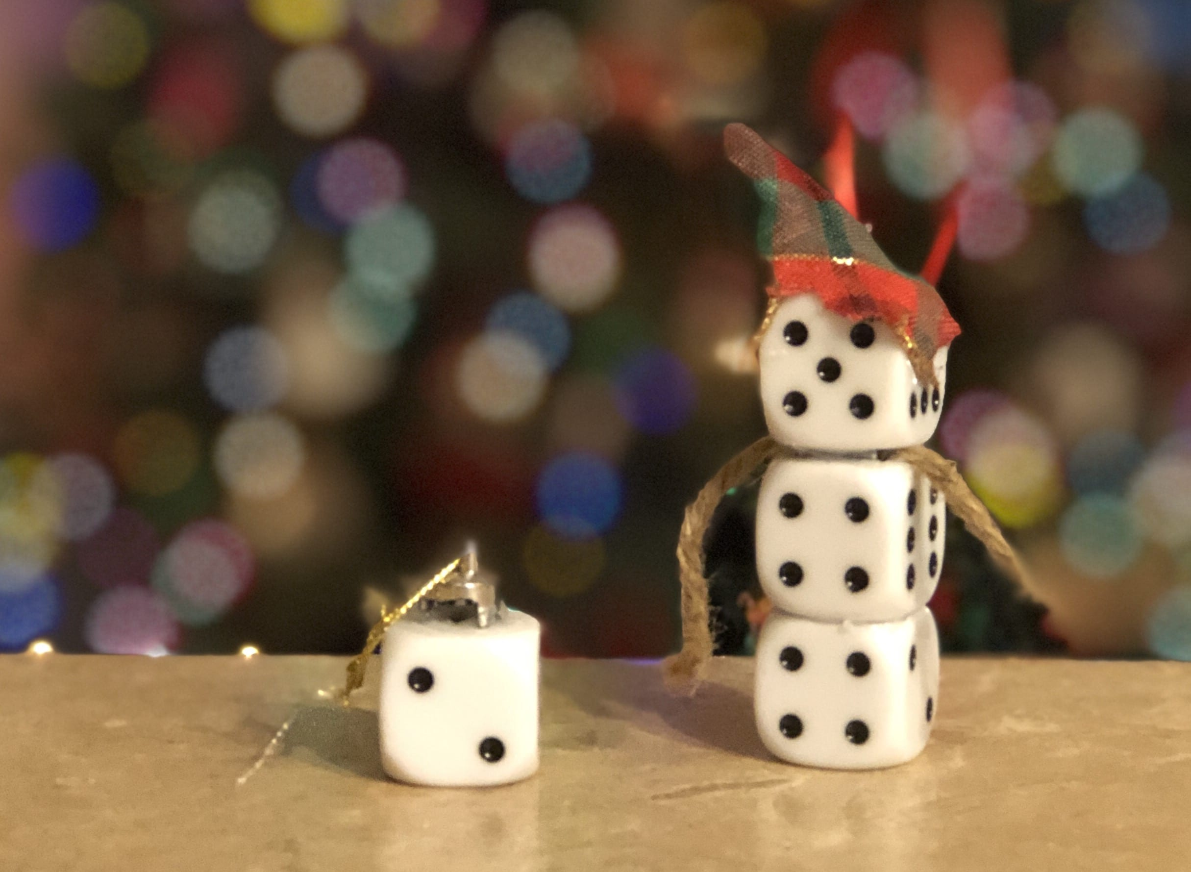 Love to play games? With a few simple craft supplies and a little imagination, you can create Christmas ornaments using game pieces.